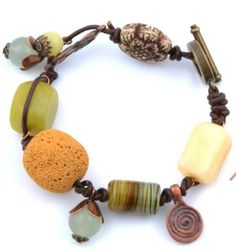"""Leather bracelet accessorized with different stones and copper pendant """"spiral of life"""""""