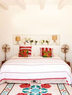 A more traditional Mexican style bedroom for Pablo's parents who visit frequently and enjoy the Mexican culture. The colors of this room still allow light to be reflected and give the openness feel that Pablo wants. By Simone Soares http://casinhacolorida-simone.blogspot.com/2013/07/inspiracao-decor-mexicana.html?m=1