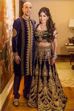 A blue velvet sherwani with gold embroidery by Mit Shah for the Sangeet of Groom Mahesh Moorjani of WeddingSutra. Photos Courtesy: Ali Ghorbani and Rock Paper Scissors Photography