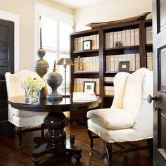 Nix the office chairs and basic desk, and replace with plush armchairs and a handsome round table, perfect for spreading out all your materials. Position a bookcase nearby to organize files and archived paperwork.