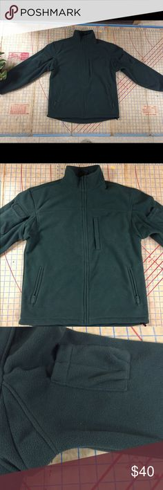 """Duluth Trading Co fleece jacket size medium In excellent condition Duluth Trading Co fleece jacket size medium. Worn a couple times, washed once and airdried. Very heavy fleece. Gussetted armpits. Zip front with neck protection. Internal drawcord at hem of coat. Deep pine green color. No damage or stains. Great to wear alone and for layering. Jacket is 30"""" in length, 23"""" across the chest and 23"""" down the sleeve. Duluth Trading Co Jackets & Coats"""