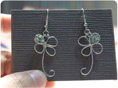 Cute wire four leaf clover. Better make it a shamrock though, crazy people think it's not irish if it's got 4 leaves. (Please, my grampa, who's parents were from Ireland, LOVED 4 leaf clovers - because they are a shamrock that's extra special. Duh.)