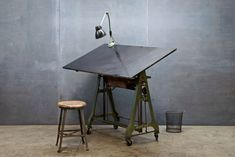 Germany, c.1930s. Vintage Marabu German Auto Plant Engineering Design Department Mechanical Lift Drafting Table. Cast Iron, Highly Adjustable (Lever for Angle, Pedal for Height), Old Growth Wooden and Black Micarta Drawing Deck.