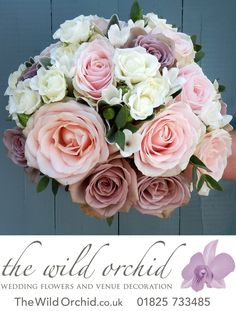 A hand tied bouquet of vintage, soft pinks and ivories and whites. Flowers include Amnesia roses, Sweet Avalanche roses, spray roses and freesia. Touches of eucalyptus throughout.