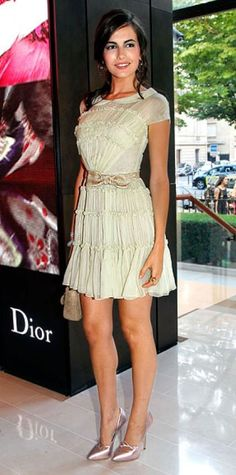 Look of the Day › June 30, 2010 WHAT SHE WORE The actress attended the launch of Christian Dior's Rouge Dior fragrance in a seafoam green chiffon design and accessories from the brand. WHY WE LOVE IT Camilla Belle was both sugar and spice in a girlish ruffled minidress that showed off her hourglass shape. A bow belt and Peter Pan collar completed Dior's nod to the ultra-feminine '50s.