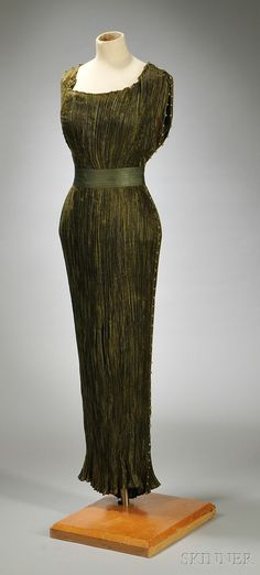 moss/olive-colored, with beading at top shoulder which continues around armholes and down side seam, with hand-decorated sash/belt,