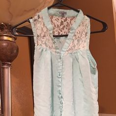 Dainty Top Light teal blue lace top size small! Purchase from Charlotte Russe! Top buttons up the front! No flaws or tears! Pairs great with cut offs or skinny jeans! Cute and dainty! Charlotte Russe Tops Blouses