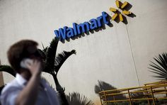 Wal-Mart Stores Inc (WMT.N) is in talks with several mobile wallet companies to offer more payment options in its Wal-Mart Pay app, an executive at the world's largest retailer said, after signing up JPMorgan Chase & Co (JPM.N) last week.