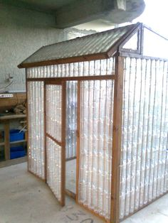 A very cool and clever way to recycle all those old water bottles!! Presenting..the water bottle greenhouse!!