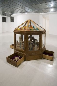 Mark Dion. Octogon Cabinet of Confectionary Wonders, 2012  mixed media (vitrine, stuffed animals, shells, rasin, insects, glass)