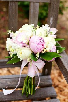 Beautiful Wedding Bouquet Featuring: White Roses, White Freesia, White Lily Of The Valley, Pink Sweet Peas, Pink Peonies, Green Lily Of The Valley Foliage Hand Tied With Pink Ribbon/Bow