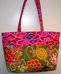 Love the fabrics used for this colorful tote. The Easy Pleaszy tote is from Pieceful Kwilter's blog