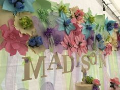 Beautiful paper flower backdrop at a butterfly birthday party! See more party planning ideas at CatchMyParty.com!