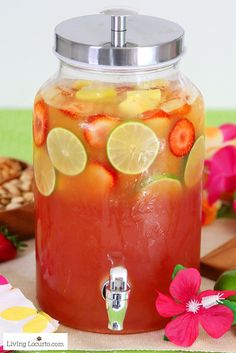 Tropical rum punch is a delicious summer cocktail recipe for a luau party or to sip by the pool! A mix of juice and coconut rum for a pretty layered drink.