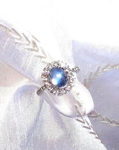 Rainbow Moonstone Halo Ring / Engagement Ring Solitaire in White Topaz Halo Setting (399.00 USD) by NorthCoastCottage