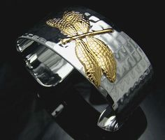 This is a beautiful 925 Sterling silver wide 18K Gold Dragonfly Cuff.  SIZE: The cuff is 30 mm wide and weights 70 gram, adjustable.   MATERIAL: Stamped 925 sterling silver.