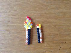 Leuke kleine Minecraft Torches gemaakt met strijkkralen (perlerbeads) met GlowInTheDark