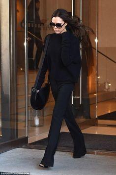 Victoria Beckham wearing Victoria Beckham Boucle Wool-Blend Sweater and Victoria Beckham Satin-Trimmed Wool-Gabardine Flared Pants