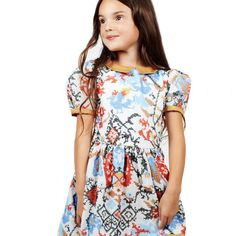 Beautiful golden #kaleidoscope #dress by #Paade. Perfect for #special #occasion #fancykids #london www.fancykids.com