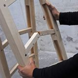 What a great space saver! A step ladder that folds up to become only as big as the four posts the hold it up. (Click the pic to see it completely folded up.)
