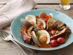 Tender littleneck clams, savory pork ribs and earthy new potatoes come together in quite the herbaceous tomato broth--the perfect dish for casual outdoor dining.
