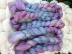 These two smaller braids total 4.2oz. This roving is 100% Blue Faced Leicester wool, which drafts easily spins nicely. Would be suitable for