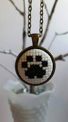 Crossstitch Paw print pendant necklace by mydisheveledducks