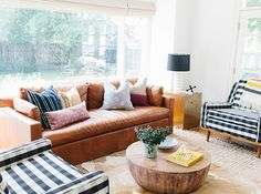 Living room with leather sofa, layered rugs and buffalo check chairs Cozy Family Rooms, Cozy Living Rooms, Living Room Sofa, Living Room Decor, Living Spaces, Estudio Mcgee, Leather Couch Decorating, Leather Sofa Decor, Living Pequeños