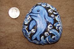 Beautiful Decorative Painting on River Rock Stone Acrylic Hand Painted Sea Dolphin By Kat. $10.00, via Etsy.