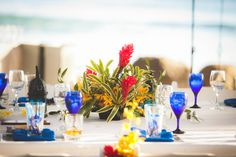 A huge fan of a colored glass or plate to match your theme...gives your table a pop of unexpected color!  www.MyWalkDownTheAisle.com