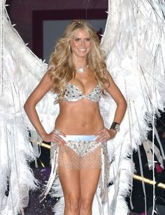 Image from http://celebsvenue.com/wp-content/uploads/2012/06/i63579_victorias-secret-fashion-show-2005-various-runway-a-backstage-_0001-788x1024.jpg.