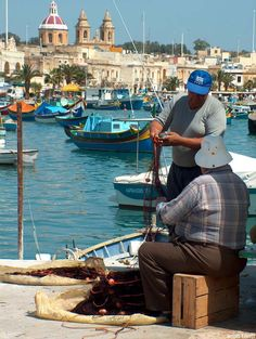 This shot captures what one is likely to come across when roaming the streets of Marsaxlokk, Malta's Fishing Village. Malta Sliema, Malta Gozo, Beautiful Islands, Beautiful World, Saint Marin, Malta History, Malta Island, Voyage Europe, Fishing Villages