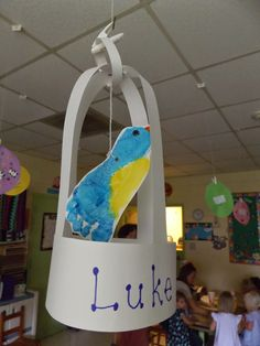 "The Stuff We Do ~ Hanging ""foot print"" birds in bird cages were made the first day of our Pet Week Theme. ~ Sherry & Melissa."