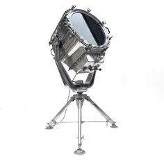 Extra large aluminum marine searchlight paired with a British Telecom satellite tripod to create a bespoke show stopping floor lamp. Fully waterproof, so can be used outdoors to light up events and create real theatre.  Width: 97cm Depth: 77cm Height: 206cm Rated: IP56 (waterproof) Weight: approx. 100kg Originally used to illuminate the banks of the Suez Canal, it was manufactured in 1996 by Famor, a Polish company who specialize in the field of lighting for the marine industry. Industrial Floor Lamps, Industrial Lighting, Modern Lighting, Outdoor Floor Lamps, Tripod Lamp, Outdoor Events, Outdoor Spaces, Vintage Industrial, Bulb