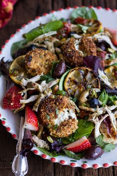 Moroccan Cumin Garlic Chicken Salad with Pistachio Crusted Fried Goat Cheese, Sundried Tomatoes, Olives, Fresh Berries, and Honey Chipotle Vinaigrette