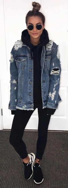 #spring #outfits woman in distressed gray denim jacket with black skinny jeans and pair of black-and-white low-top sneakers outfit. Pic by @london_fashion_and_style