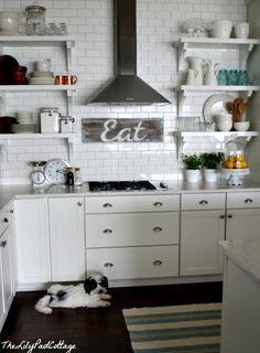 Kitchen: subway tiles, range hood, shelving