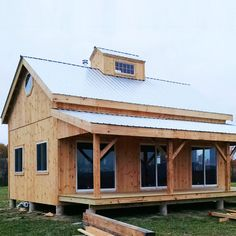 20x30 Cabin - Customized with the 8x30 Overhang upgrade and a custom built cupola with windows.