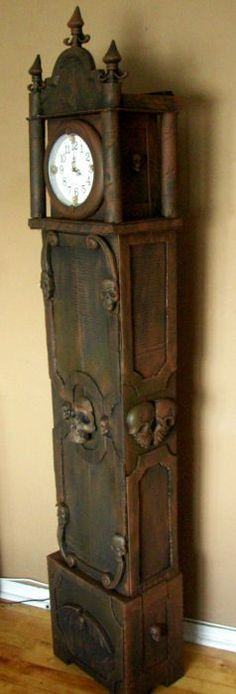 MAKING THIS!!!!!! Grandfather clock made from cardboard and Dollar store items. http://www.halloweenforum.com/members/theundeadofnight.html http://theundeadofnight.wix.com/theundeadofnight
