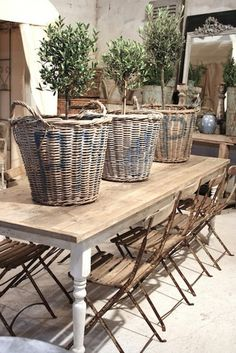 French baskets on farm table with cafe chairs in French farmhouse decorated room. French Farmhouse Decor Inspiration Ideas will take you on a romantic tour of images capturing this charming decor style. Farmhouse Decor, French Farmhouse Table, Decor, French House, Rustic French, Outdoor Decor, Decor Inspiration, French Decor, Basket