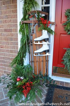 Christmas Porch with Triple Wreaths | http://betweennapsontheporch.net/front-porch-decorated-for-christmas/