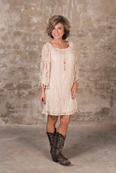 The Teegan Dress is stunning! Featuring a round elasticized neckline, to wear on or off the shoulder and 3/4 bell sleeves with tassel detail at cuff. The sheer lace overlay is fully lined except for the sleeves.