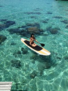 """""""Here's a picture of paradise! (And the scenery isn't bad either!) We literally took the paddle board out from our back porch which goes right into the water! In fact, those boards to the bottom left is our patio! Tahiti is amazing!""""....I wish seeing this photo that I lived there lol =)"""