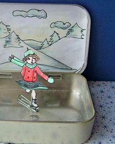 Ice skating paper doll craft using an altoid tin! skates around with magnet underneath!