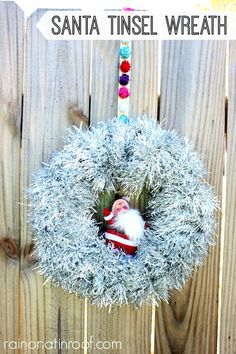 If you want to make a cute and super easy wreath, tinsel is the way to go. This is so easy and that Santa is the icing on the cake! via RainonaTinRoof.com