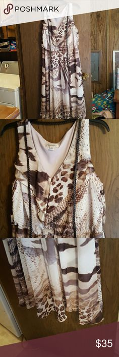 DRESS BARN, Size 16, LINED, SLEEVELESS DRESS NWOT Dress Barn Beautiful Sleeveless Dress Ruffled V-Neck Flounce Skirt Bottom, fully lined, Skinny Brown Braided Leather Belt, Size 16 NWOT. Never got to wear this dress, make my loss your gain! BEAUTIFUL NECKLACE AND  EARRINGS, FREE WITH PURCHASE!  😄 Dress Barn Dresses Midi