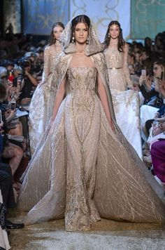 Elie Saab Couture - She could take things up a notch with this dramatic hooded cape turned cathedral train. No one does dresses like Elie Saab, and wedding gowns are no exception. Elie Saab Couture, Gowns Couture, Look Fashion, Runway Fashion, Fashion Show, Latest Fashion, Fashion Check, Woman Fashion, Fashion Fall