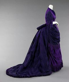 Afternoon Dress by the House of Worth, circa 1872. The extraordinary purple color and variety of textiles in this dress attest to the refinement of the French textile industry. Fine variations between the satin and bengaline illustrate how Worth built his reputation on subtlety and luxury.  Source: MET. #Victorian #Fashion
