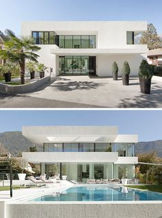 House Exterior Colors - 11 Modern White Houses From Around The World // Walls of windows break up the all white exterior of this modern family home.
