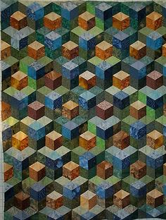 I love quilts that contain illusions. This one by Karen Combs is a variation of Tumbling Blocks.
